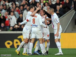 Lyon players celebrate Mounier's clinching second goal against Sochaux.