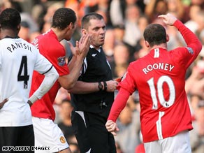 Wayne Rooney confronts referee Phil Dowd following his dismissal during the defeat at Fulham.