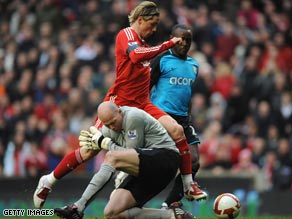 Friedel attempts to avoid the incoming Torres and was sent off for his troubles.