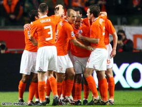Dutch players celebrate their opening goal in the comfortable 3-0 victory over Scotland.
