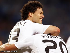 Michael Ballack, left, gave group leaders Germany an early lead in their World Cup clash.