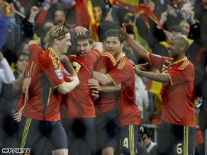 Pique (center) is congratulated by teammates after his crucial goal in the Bernabeu.
