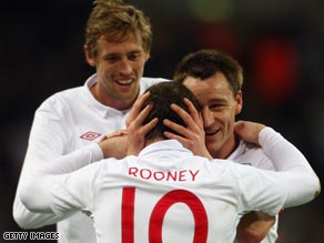 Crouch, left, and Rooney lead England's win bid in the World Cup tie against big rivals Ukraine at Wembley.