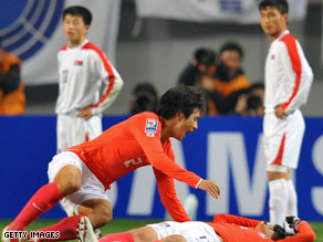 South Korea's Oh Beom-Seok, left, celebrates with Kim Chi-Woo after Kim's late goal Wednesday in Seoul.