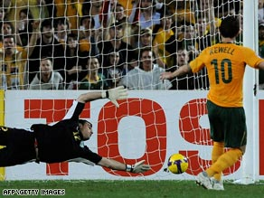 Harry Kewell converts from the spot to leave Australia on the brink of a place at the 2010 World Cup finals.