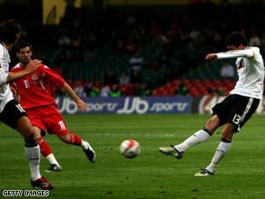 Michael Ballack fires home the opening goal in Germany's 2-0 victory in Wales on Wednesday.