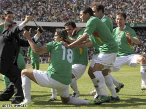Bolivia players celebrate another goal as they humiliated Argentina 6-1 in La Paz.
