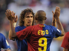 Eto'o is congratulated by his team-mate Carlos Puyol after his 40th minute goal