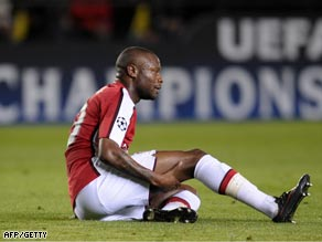 Gallas clutches his leg after sustaining a knee ligament injury against Villarreal on Tuesday.