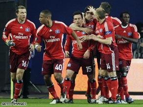 Hamburg celebrate their equalizer on the way to taking a crucial UEFA Cup first-leg lead over Man City.