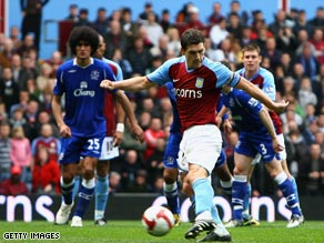 Gareth Barry fires home Aston Villa's equalizer in their thrilling 3-3 draw with Everton on Sunday.