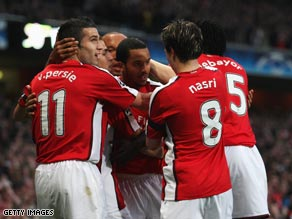 Theo Walcott is congratulated by team-mates after scoring Arsenal's opening goal against Villarreal.