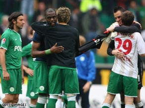Grafite is congratulated by a teammate after Wolfsburg's 2-1 home win.