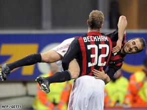 Beckham and Mathieu Flamini take part in an unusual goal celebration in the San Siro.