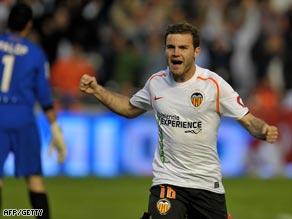 Mata celebrates his successful penalty to put Valencia ahead.