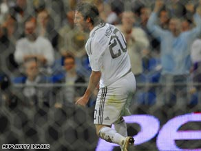 Higuain scored twice as Real Madrid snatched a last-gasp victory  to move within three points of leaders Barcelona.