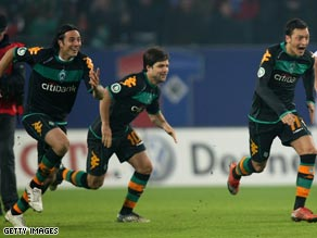 Bremen players celebrate their dramatic German Cup semifinal victory over Hamburg.