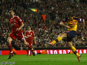 Andrey Arshavin scores his and Arsenal's fourth in the rollercoaster 4-4 draw with Liverpool at Anfield.
