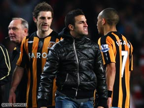 Fabregas (center) faces two charges of misconduct following Arsenal's FA Cup victory over Hull City.