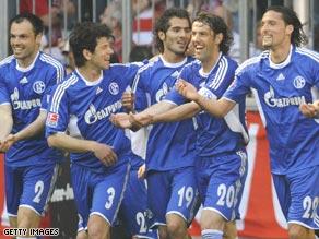 Schalke's overjoyed players celebrate Altintop's winning goal.
