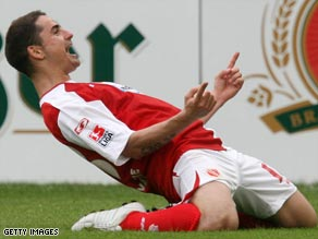 Eervin Skela celebrates his goal as Energie Cottbus stunned Bundesliga leaders Wolfsburg 2-0.
