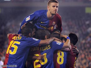 Barcelona celebrate their opening goal, but they needed a late equalizer to draw 2-2 at Valencia on Saturday.