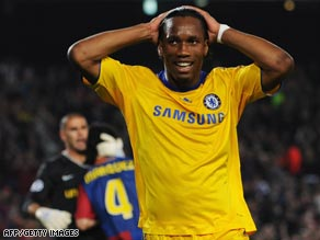 Didier Drogba holds his head after wasting a golden chance to put Chelsea ahead at the Nou Camp.