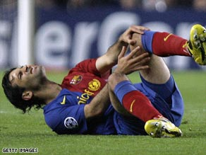 Marquez goes down clutching his knee in the Camp Nou clash with Chelsea.
