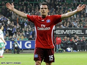 Piotr Trochowski celebrates the only goal as Hamburg took a major step towards the UEFA Cup final.
