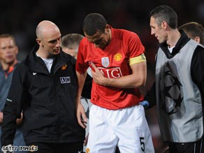 A dazed Ferdinand is helped from the field after damaging his ribs against Arsenal on Wednesday.