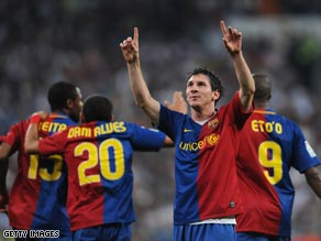 Messi celebrates his second and Barcelona's fifth in the 6-2 rout at the Bernabeu.