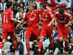 Dirk Kuyt (second left) is congratulated by team-mates after scoring Liverpool's second goal on Sunday.