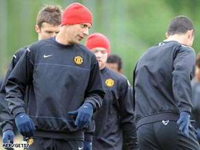 Ferdinand trains at United's Carrington facility ahead of the Champions League clash.