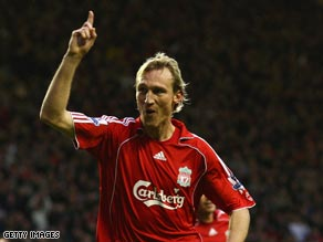 Hyypia celebrates one of the 35 goals he has scored for Liverpool.