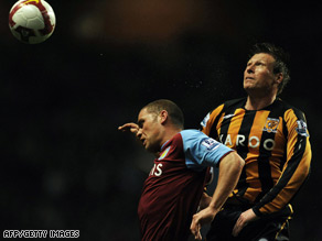 Aston Villa's Luke Young and Hull City's Nick Barmby rise for the ball on Monday.