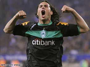 Claudio Pizarro celebrates scoring Werder's second goal in their thrilling 3-2 victory over Hamburg.