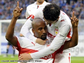 Cacau celebrates his opening goal in Stuttgart's crucial 2-1 victory at Schalke in Wednesday.