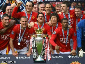 United players celebrate after securing the draw against Arsenal that sealed the championship.