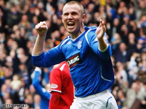 Kenny Miller celebrates scoring Rangers' second goal in their 2-1 home victory over Aberdeen.