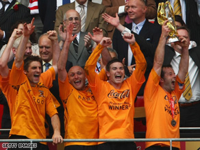 $100m smiles? Hull City players celebrate after winning last year's Championship play-off match