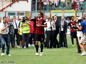 Maldini salutes the crowd on his lap of honor as his San Siro career ends in a 3-2 defeat by Roma.