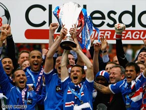 Rangers celebrate winning the Scottish title  after three seasons of Celtic dominance.