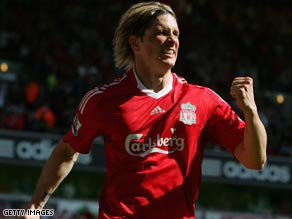 Fernando Torres celebrates after scoring in the win over Tottenham, securing Liverpool's second-placed finish.