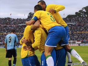 Brazil players celebrate Juan's second goal in their 4-0 thrashing of Uruguay.