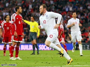 Rooney wheels away after scoring his second and England's third.