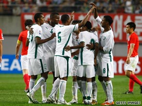 Saudi players celebrate their hard-earned point in the 0-0 draw against South Korea.