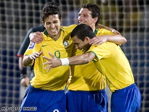 Brazil's match-winner Nilmar, left, celebrates his goal with Elano and Daniel Alves, right.