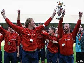 Players from the London Stonewall Lions hold the 2008 Gay World Soccer Championship trophy aloft