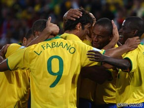 Brazil players celebrate after Maicon's third goal in their comfortable victory over the United States.