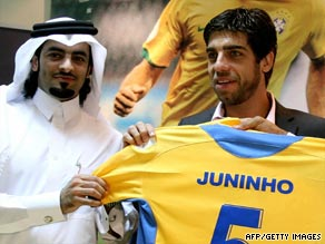 Juninho is presented with his new jersey after completing his move to Qatari champions Al-Garrafa.